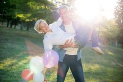 Happy couple having fun at the park Stock Photo