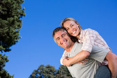 Happy couple having fun in the park Stock Photography