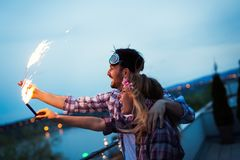 Happy couple having fun and partying on balcony. During sunset Royalty Free Stock Image