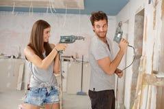 Happy couple having fun at renovation Stock Image