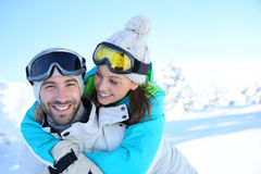 Happy couple having fun on the slopes Stock Photos