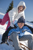 Happy couple having fun in the snow Royalty Free Stock Images