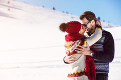 Happy Couple Having Fun on snow mountain. Stock Photos