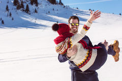 Happy Couple Having Fun on snow mountain. Stock Image