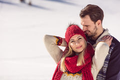Happy Couple Having Fun on snow mountain. Stock Photo
