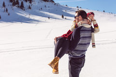 Happy Couple Having Fun on snow mountain. Royalty Free Stock Images