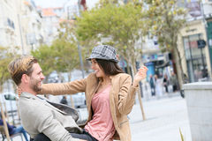 Happy couple having fun in the streets Royalty Free Stock Photography