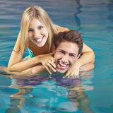 Happy couple having fun in swimming pool Royalty Free Stock Images