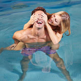 Happy couple having fun in swimming Royalty Free Stock Image