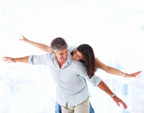 Happy couple having fun together Stock Image