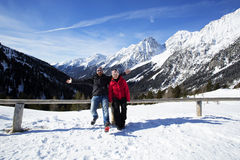 Happy couple having fun in winter landscape Royalty Free Stock Image