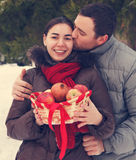 Happy couple having fun in the winter park Stock Images