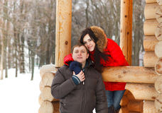 Happy couple having fun in the winter park Royalty Free Stock Photography