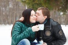 Happy couple having fun in the winter park Stock Image
