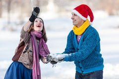 Happy couple having fun at winter time outdoor. Royalty Free Stock Photography