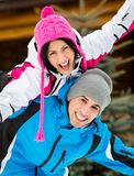Happy couple having fun during winter vacations Stock Images