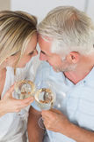 Happy couple having glass of wine together Royalty Free Stock Photography