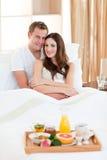 Happy couple having an healthy breakfast Stock Photos
