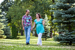 Happy couple, having joined hands walk in park Royalty Free Stock Photo