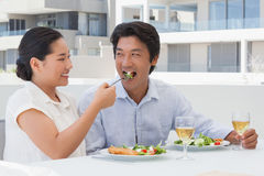 Happy couple having a meal together Stock Image