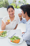 Happy couple having a meal together with white wine Royalty Free Stock Image