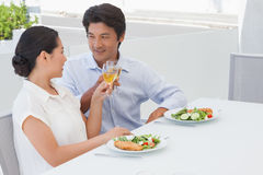 Happy couple having a meal with white wine Royalty Free Stock Photo