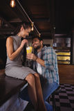 Happy couple having milkshake. In restaurant Stock Photo