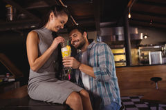 Happy couple having milkshake. In restaurant Stock Photos