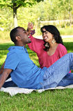 Happy couple having picnic in park Stock Images