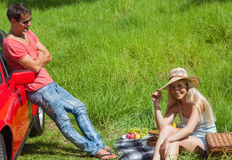 Happy couple having picnic together Royalty Free Stock Photos