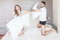 Happy Couple Having Pillow Fight Royalty Free Stock Images