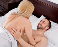 Happy couple having sex in bed Royalty Free Stock Photos