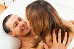 Happy couple having sex. On bed in home interior Royalty Free Stock Images