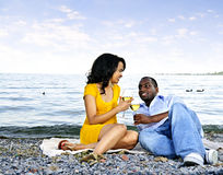 Happy couple having wine on beach Royalty Free Stock Images