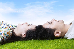 Happy couple with heads together on field Royalty Free Stock Photography