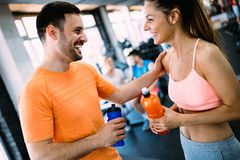 Happy couple in a health club stock image
