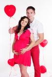 Happy couple with heart shape balloons Stock Photos