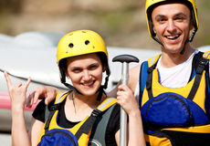 Happy couple with helmets Stock Image