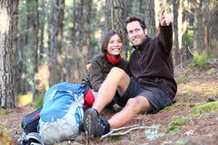 Happy Couple hikers hiking in autumn forest stock photos