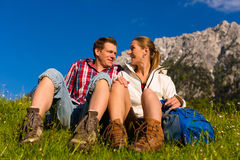 Happy Couple hiking in alp mountains Stock Photos