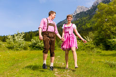 Happy couple hiking in Alpine meadow Stock Images