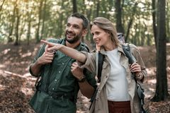 Happy couple hiking in the autumns woods Royalty Free Stock Photos