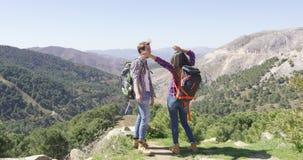 Happy couple hiking stock video