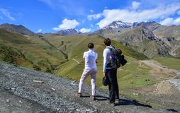 Happy couple hiking in mountains royalty free stock images