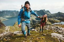 Happy Couple hiking in Norway mountains love and travel royalty free stock photos