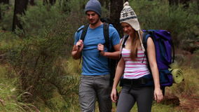 Happy couple hiking and taking a break stock video footage