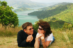 Happy couple at a hill top over Marlborough sound. Happy couple at a hill top over scenic Queen Charlotte sound bay from. Marlborough. New Zealand Royalty Free Stock Image