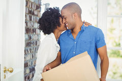 Happy couple holding box Stock Photography