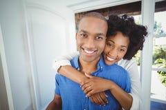 Happy couple holding box Stock Photos