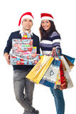 Happy couple holding Christmas presents stock photos